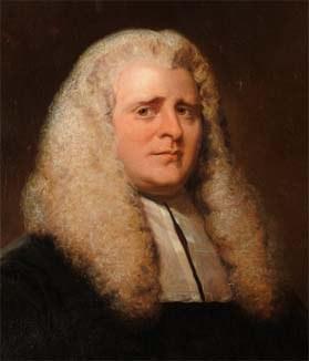 Sir John Wilson, posant aux côtés de ses deux caniches. (source: https://fr.wikipedia.org/wiki/John_Wilson_(math%C3%A9maticien))